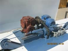 Регулировка высоты  подающих валов многопильного станка DC-210